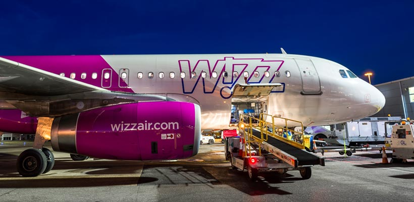 Wizz Air loading luggage at Luton Airport.